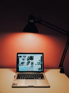 Desk with laptop and desk lamp
